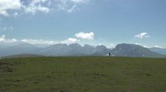 Hikers Walking on a Mountain Meadow 4K Stock Footage