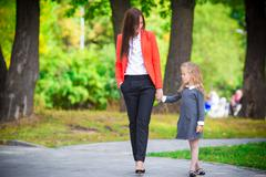 Mother brings her daughter to school. Adorable little girl feeling very excited - stock photo