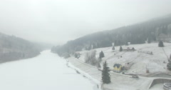 Aerial: Storage lake of Spindler Mill, Czech Republic in winter Stock Footage