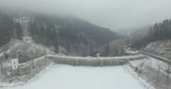 Aerial: The reservoir and bridge of Spindler Mill, Czech Republic in winter Stock Footage
