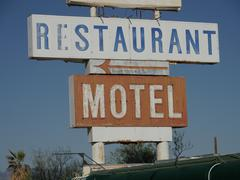 Restaurant and motel signposts - stock photo