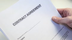 Man With A Blank Contract Agreement Form Stock Footage