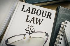 Labour or labor law book. Legislation and justice concept. Stock Photos