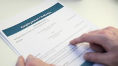 Analyzing Employment Contract Form Stock Footage