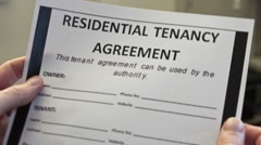 Male Hands Holds Residential Tenancy Agreement Form Stock Footage