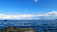 Time lapse view toward the sea from seashore Stock Footage