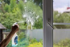 Detergent on the dirty window Stock Photos