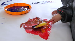 Babies Playing with Paints in Kindergarten Childcare - stock footage