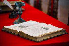 Old medieval open book on table Stock Photos