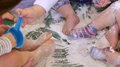 Babies Playing with White Flour in Kindergarten Childcare - stock footage