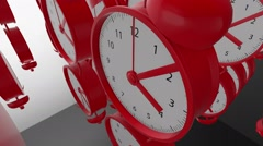 Moving rows of Alarm clocks in red color Stock Footage