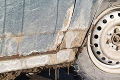Rusty car, metal corrosion and traces of reagents, Stock Photos