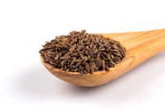 Caraway seeds in spoon Stock Photos