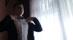Young man corrects his jacket before the wedding Stock Footage