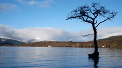 Timelapse of Loch Tay in the Scottish Highlands during a clear winters day Stock Footage