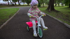 Girl on a pink tricycle Stock Footage