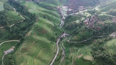 CINEMATIC AERIAL FLY OVER TIANTOUZHAI VILLAGE & JINKENG RICE TERRACE Stock Footage