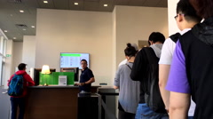 People line up for waiting service inside TD bank with 4k resolution Stock Footage