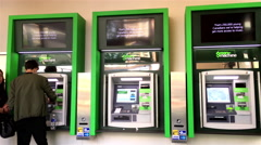 People withdrawing money at ATM machine inside TD bank with 4k resolution - stock footage