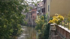Houses and balcony hanging above Rio Sottoriva river in Mantua Stock Footage