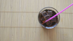 Two hands put two glasses of cola with ice Stock Footage