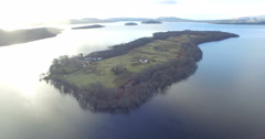 Aerial: Island in the Scottish Highlands during a beautiful clear winters day Stock Footage