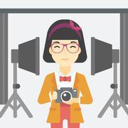 Smiling photographer holding camera Stock Illustration