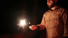 Guys with sparklers in the camp night Stock Footage