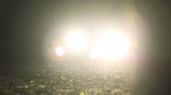Bright light of car headlights at night in the forest Stock Footage
