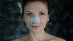4k Shot of a Woman Posing in Studio with a Cleansing Plaster on Nose - stock footage