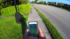 Person playing pokemon go Stock Footage