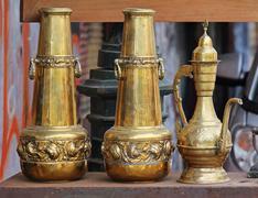 Aged gold antiquities sold on flea market Stock Photos