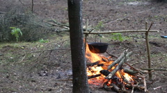 Cooking soup in a pot on the fire Stock Footage