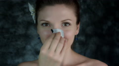 4k Shot of a Woman Posing in Studio with Cleansing Plater on Nose Stock Footage
