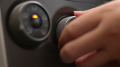 Man turning on or off car air conditioning system Stock Footage
