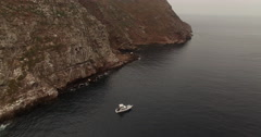 Boat Anchored Near an Island Stock Footage