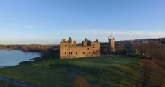 Aerial: Linlithgow Palace beside Linlithgow Loch, Scotland Stock Footage