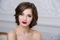 Portrait of beautiful woman with red lips at luxury interior room Stock Photos