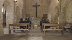 Mourners at funeral service in church - stock footage