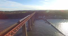 Aerial: Train on Forth Rail Bridge in Queensferry, Edinburgh, Scotland Stock Footage