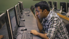 Frustrated Indian man at computer screen Stock Footage