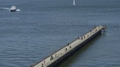 Pier 14 a pedestrian walkway that stretches out into San Francisco Bay Stock Footage