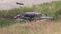 Ambulance at scene of car accident and crash with three people dead on highway Stock Footage