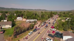 Aerial shot of people watching the small town parade in Utah Stock Footage
