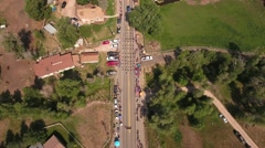 Aerial shot of the crowds watching a small town parade in Utah Stock Footage