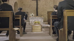 Mourners at funeral service in church Stock Footage
