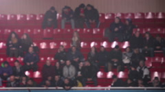 Spectators sit in the stands. Real time. Stock Footage