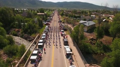 Aerial shot of the families watching marching band in small parade Stock Footage