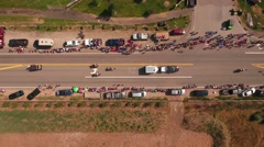Aerial shot people watching a small town parade in Utah Stock Footage