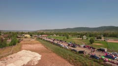 Aerial shot people watching a small town parade Stock Footage